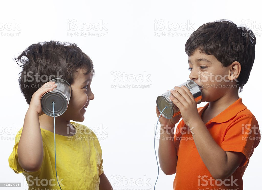 Little Boys Communicating Via Can Phone stock photo