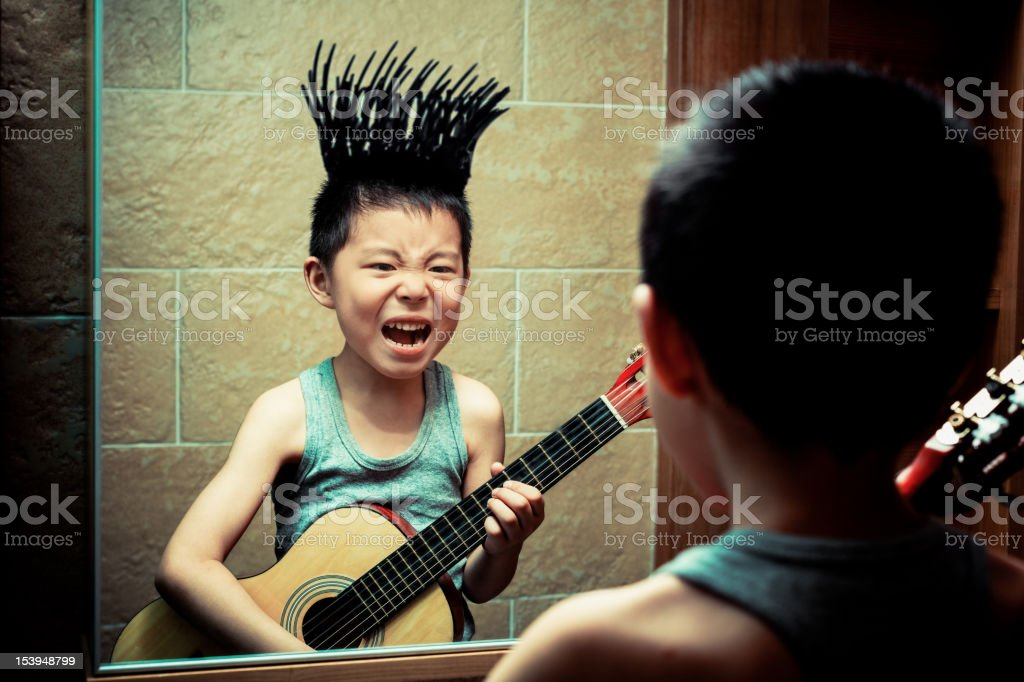 Little boy's graffiti in the bathroom mirror stock photo