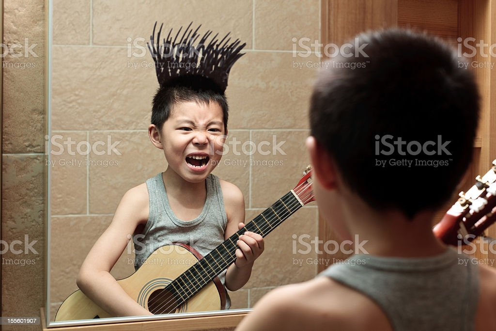 Little boy's graffiti in the bathroom mirror royalty-free stock photo