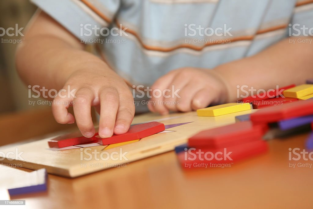 Little Boy's Hands Closeup While Playing with Blocks stock photo