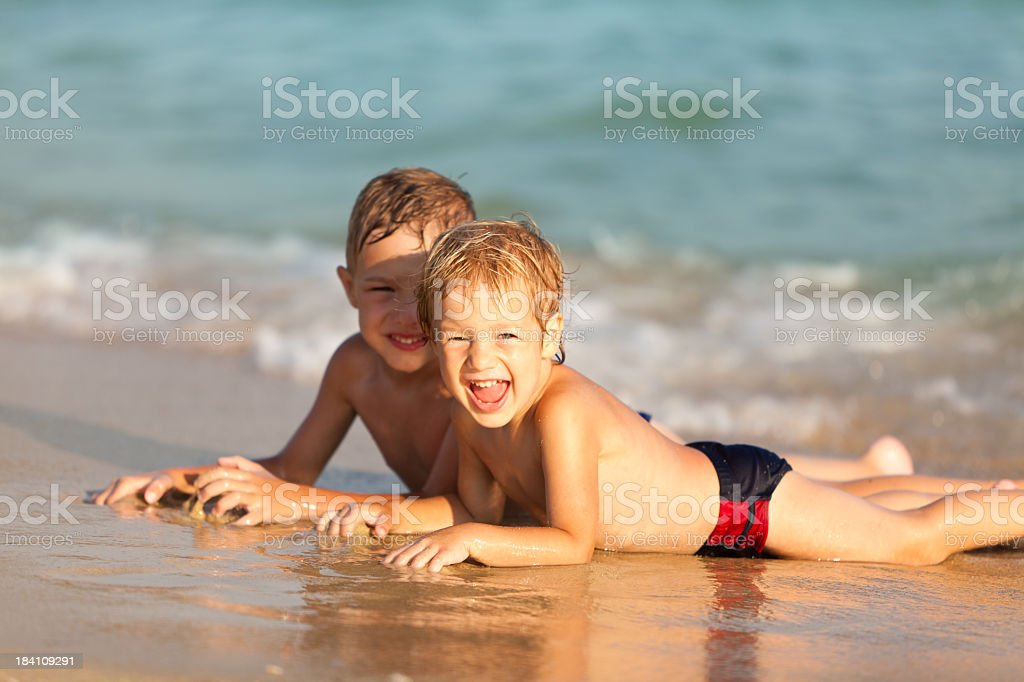 Little Boys Having Fun At The Sea royalty-free stock photo