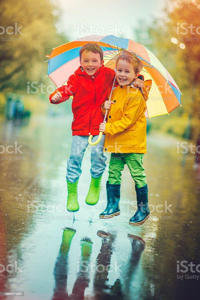 Little boys in rain stock photo
