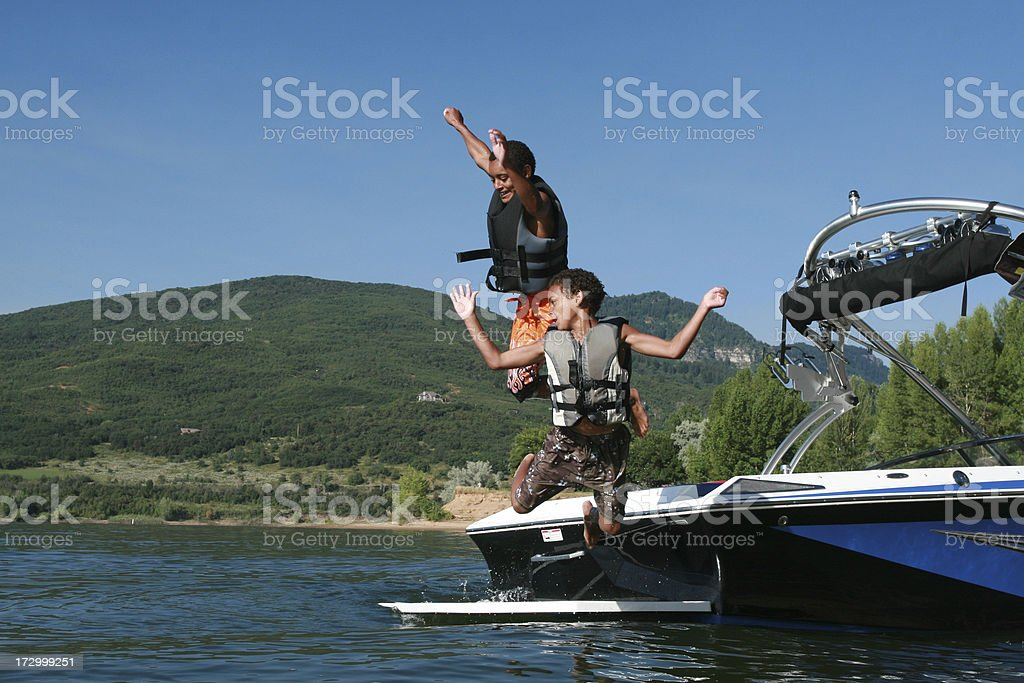 Little Boys jumping from boat royalty-free stock photo