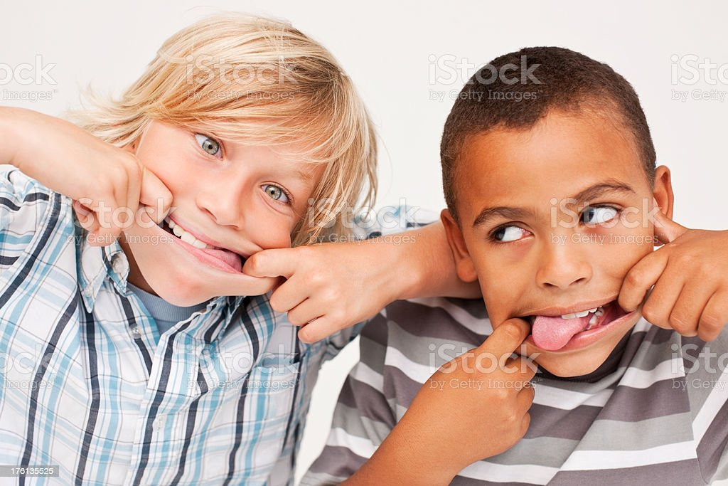Little boys making funny faces royalty-free stock photo