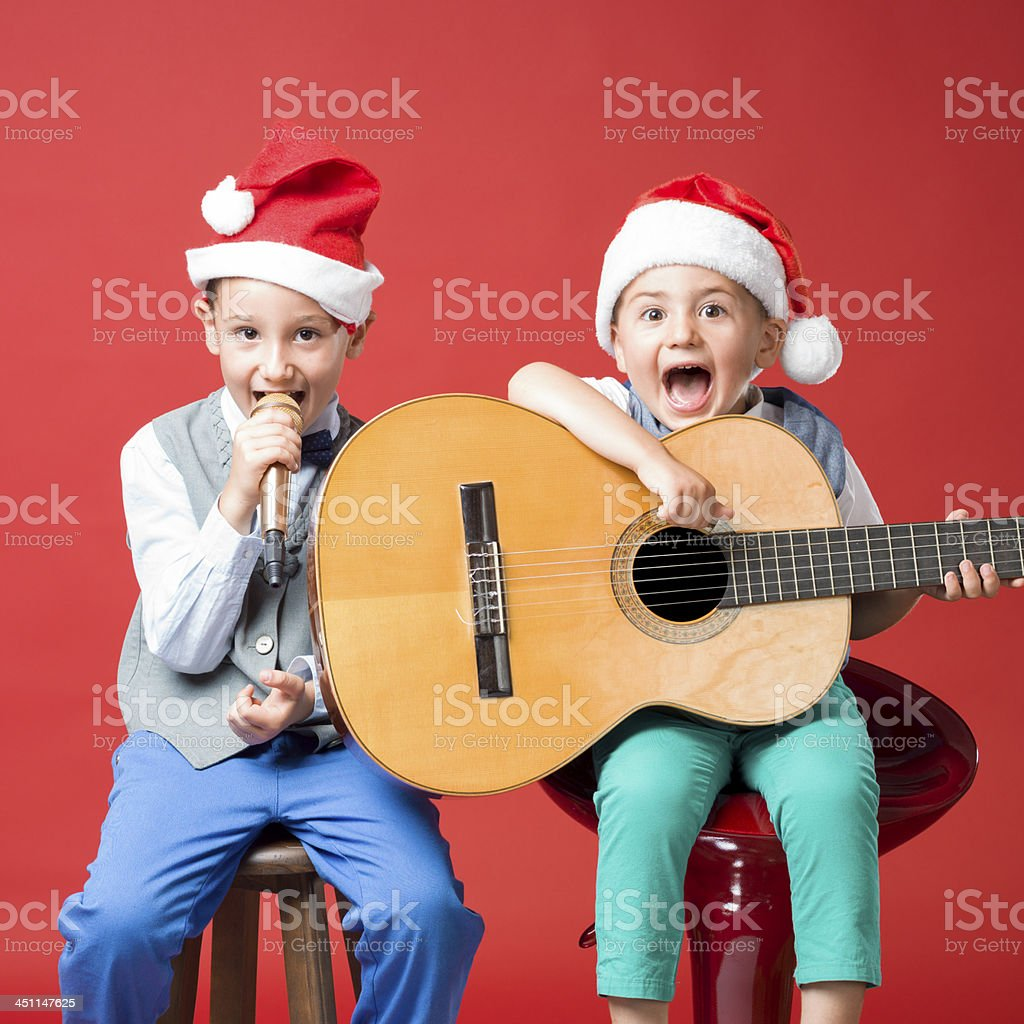 Little boys making music for Christmas stock photo