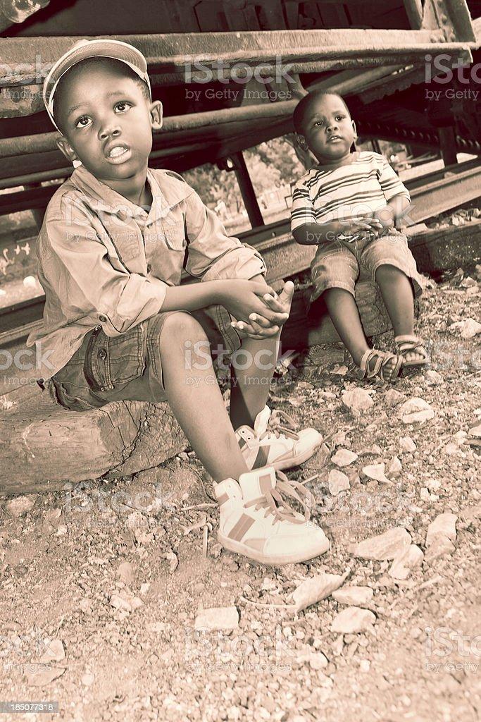 Little boys on a railway track stock photo