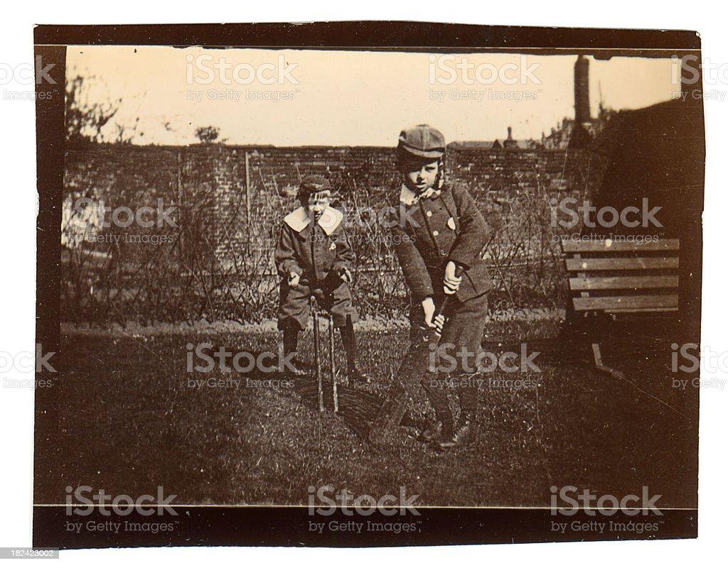 Little boys playing cricket stock photo