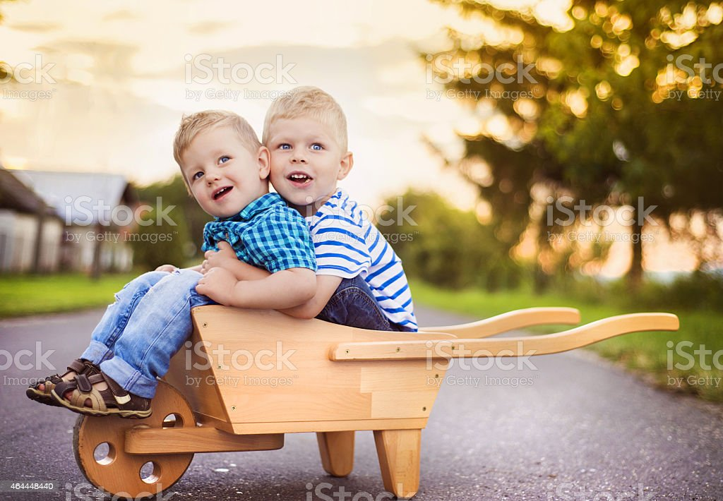 Little boys playing outside the house stock photo