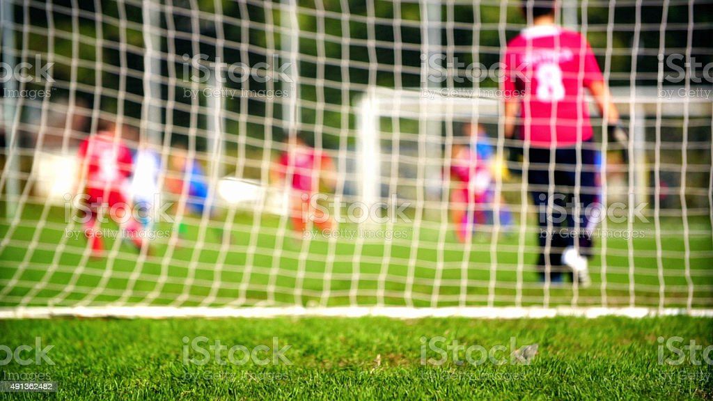 Little boys playing soccer. stock photo