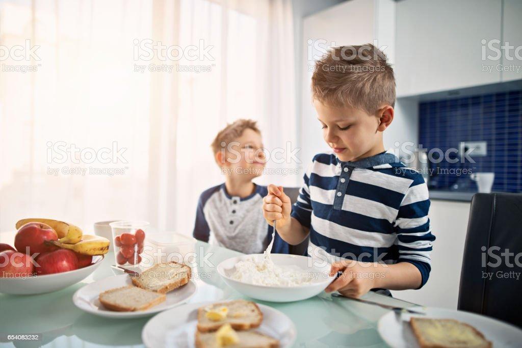 Little boys preparing breakfast stock photo