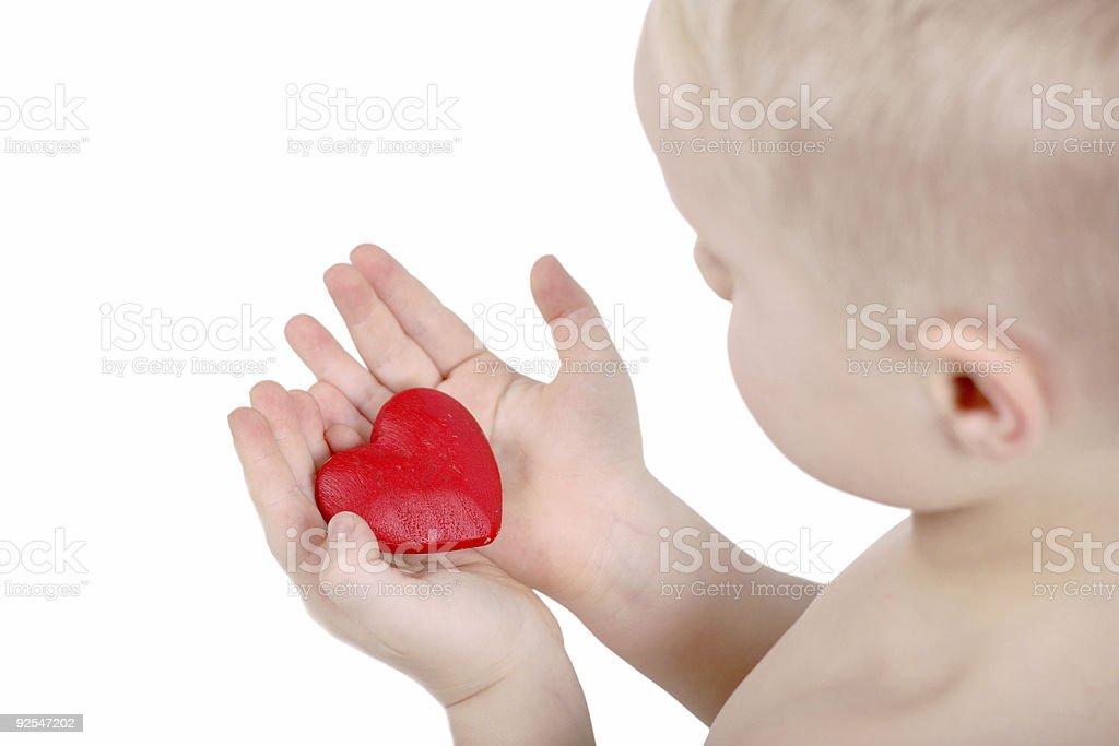 Little boys red heart stock photo