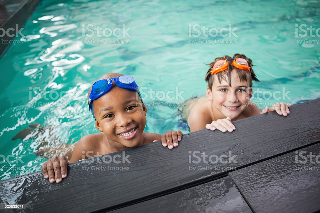 Little boys smiling in the pool stock photo