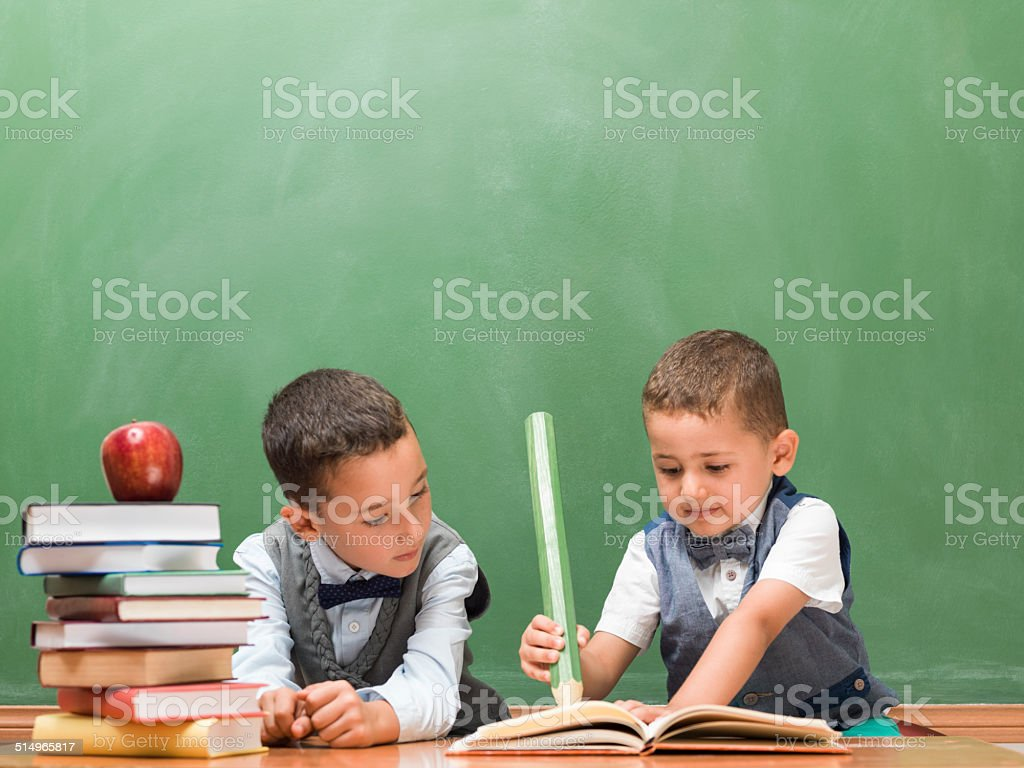 Little boys writing with big pencil stock photo