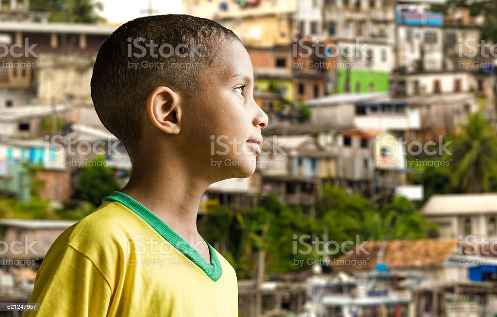 Little Brazilian boy in a colorful background stock photo