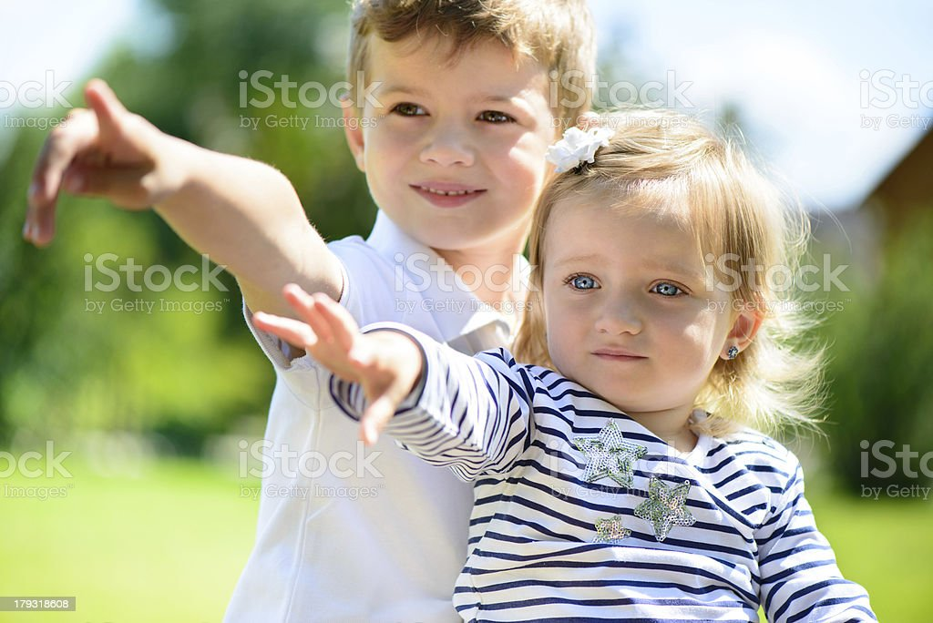 Little brother and sisiter pointing royalty-free stock photo