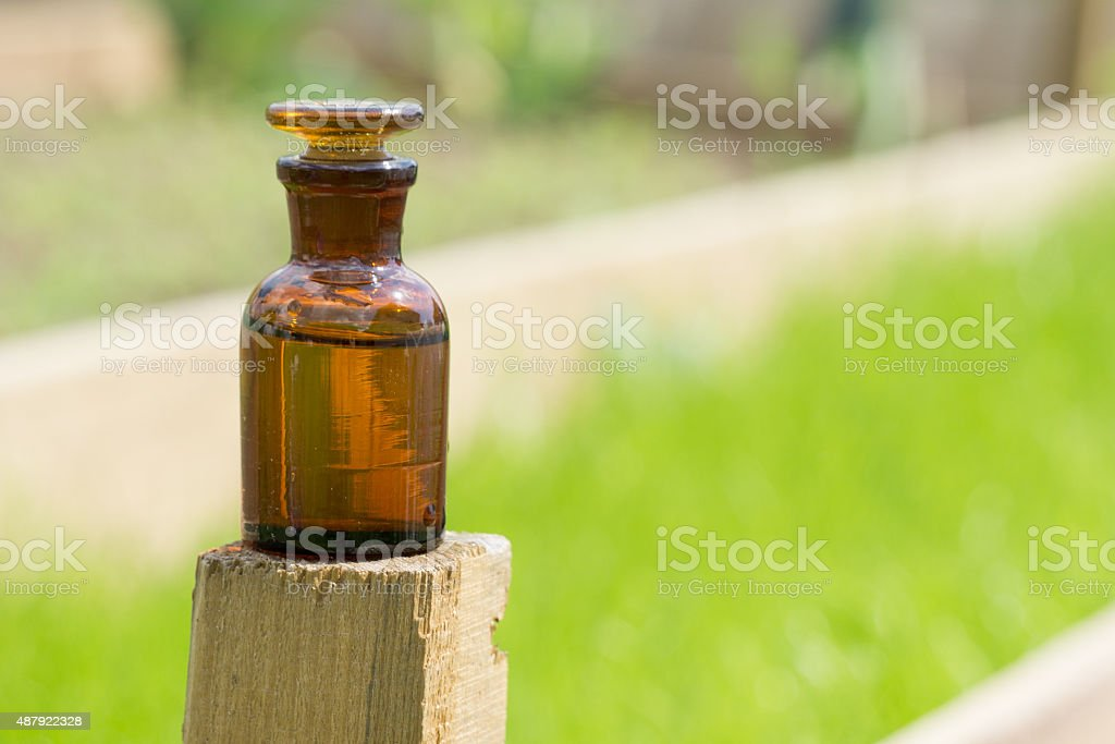 little brown bottle and grass stock photo