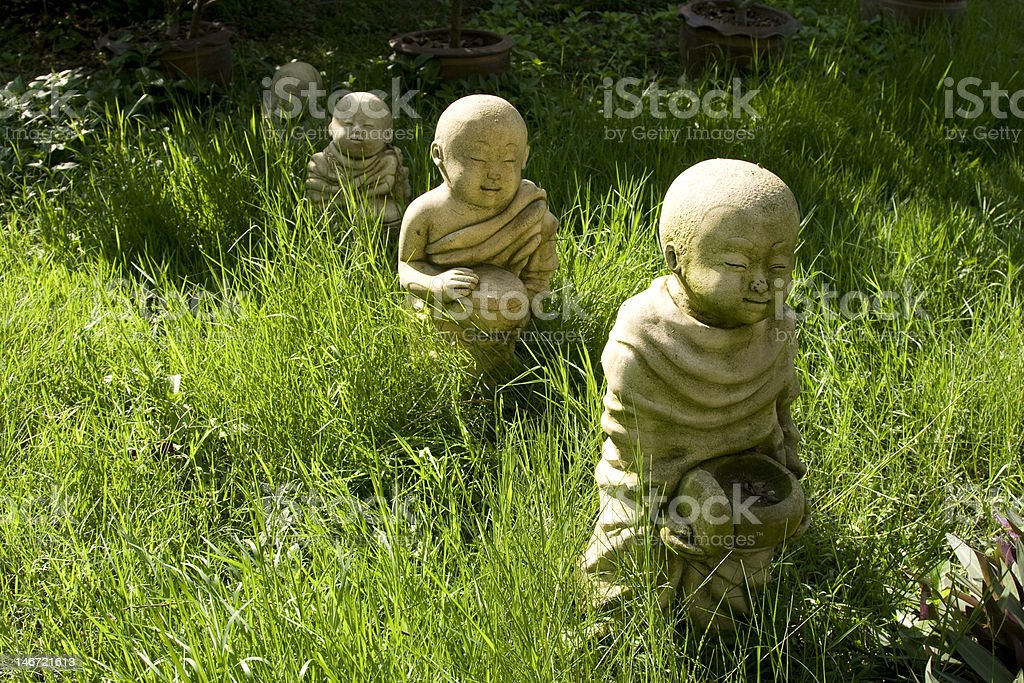 Little Buddhas in the Grass royalty-free stock photo