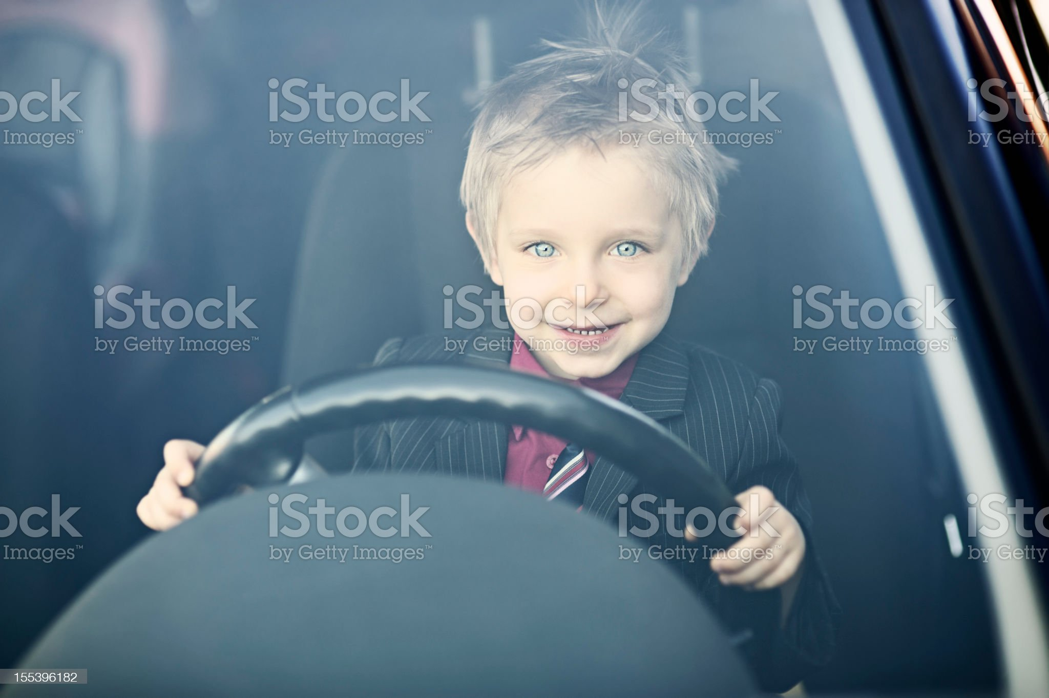 Little business boy driving to work. royalty-free stock photo