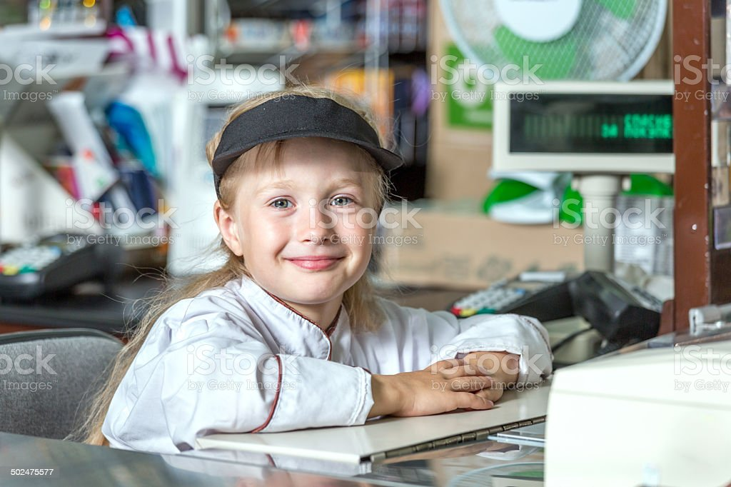 Little cashier in big shop royalty-free stock photo