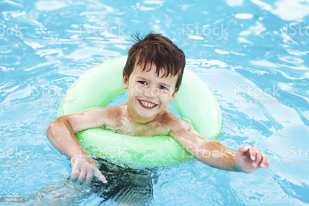 Little caucasian boy learning swim with saver royalty-free stock photo