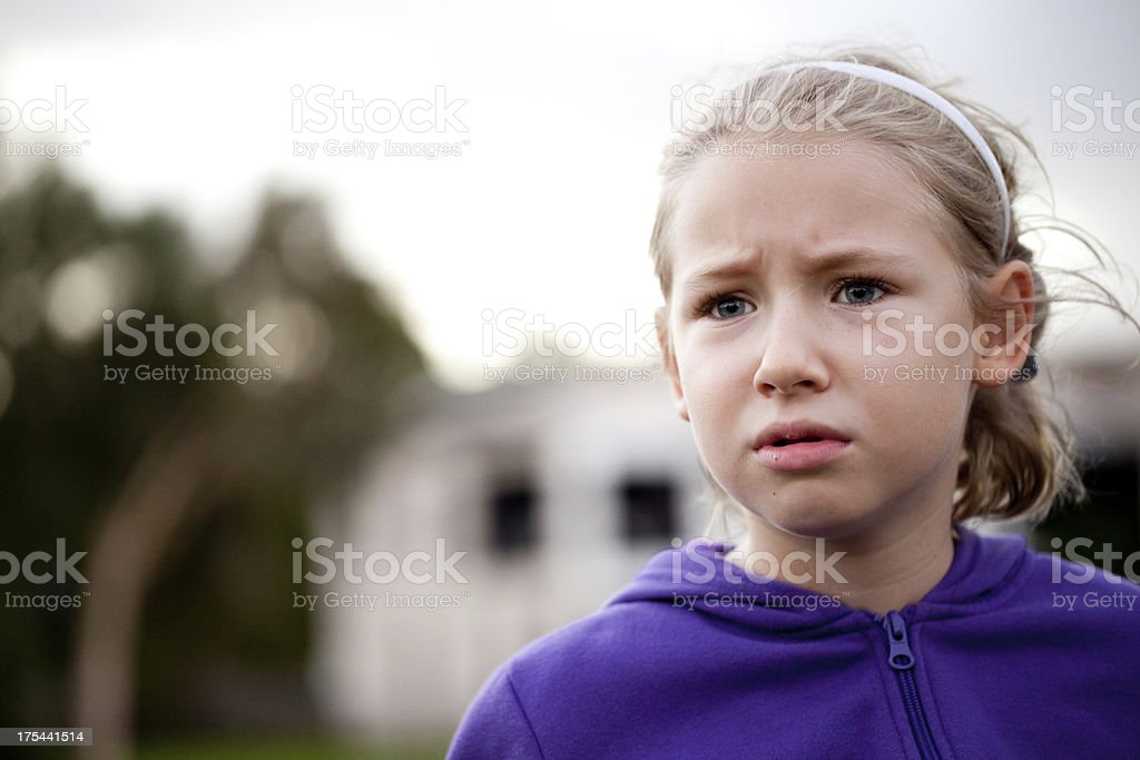 Little caucasian girl worried confused stressed outdoors royalty-free stock photo
