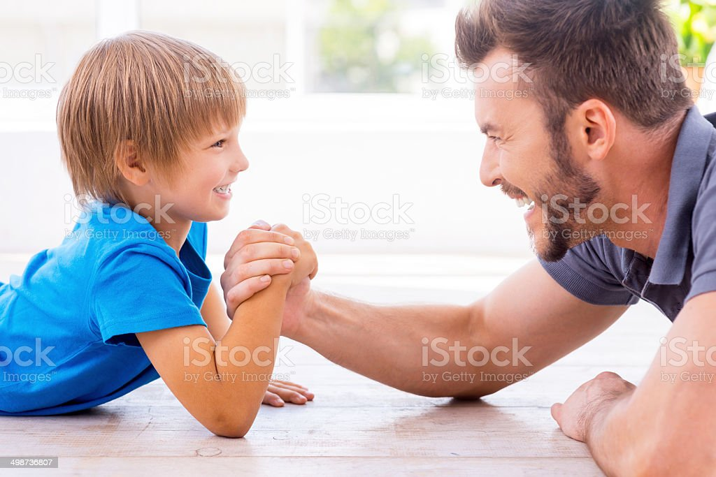 Little champion in arm wrestling. stock photo
