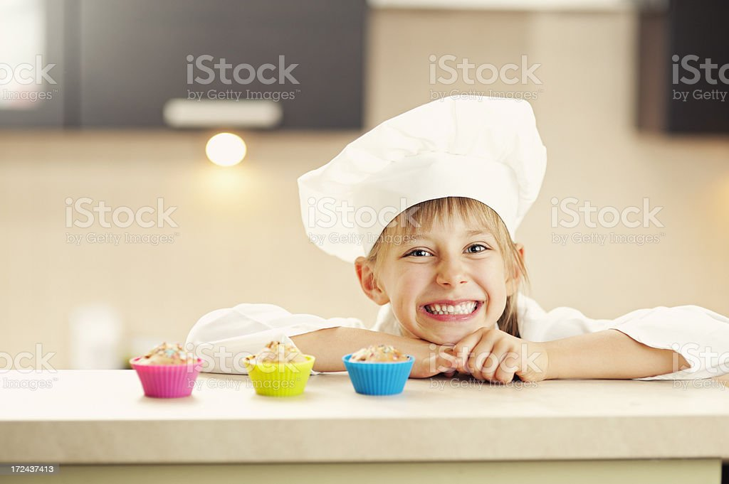 Little chef and her cupcakes royalty-free stock photo