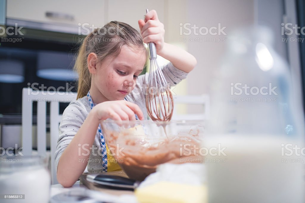 Little chef baking muffins stock photo
