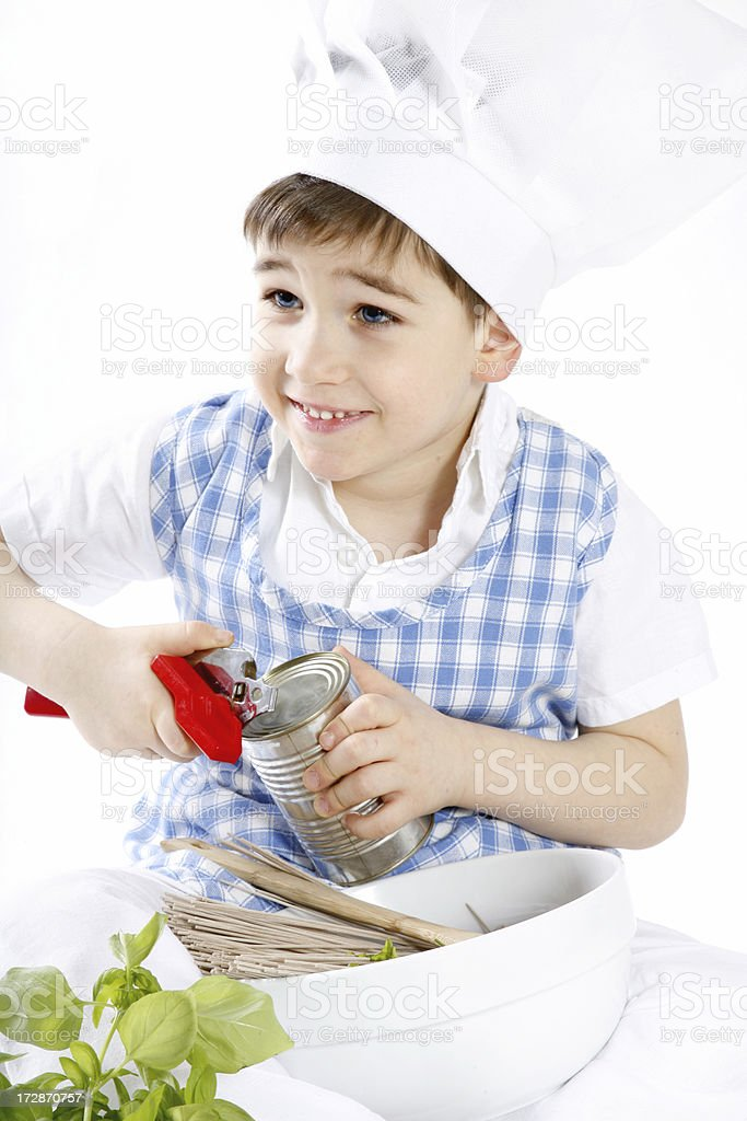little chef  is making spaghetti on the white background royalty-free stock photo