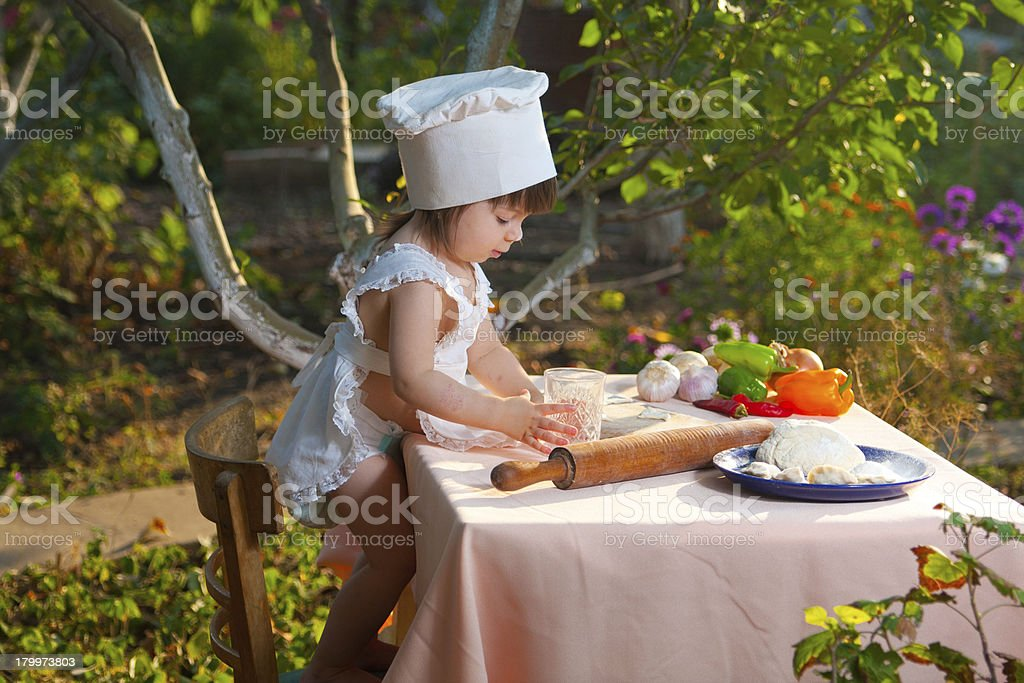 Little chef makes the dough royalty-free stock photo