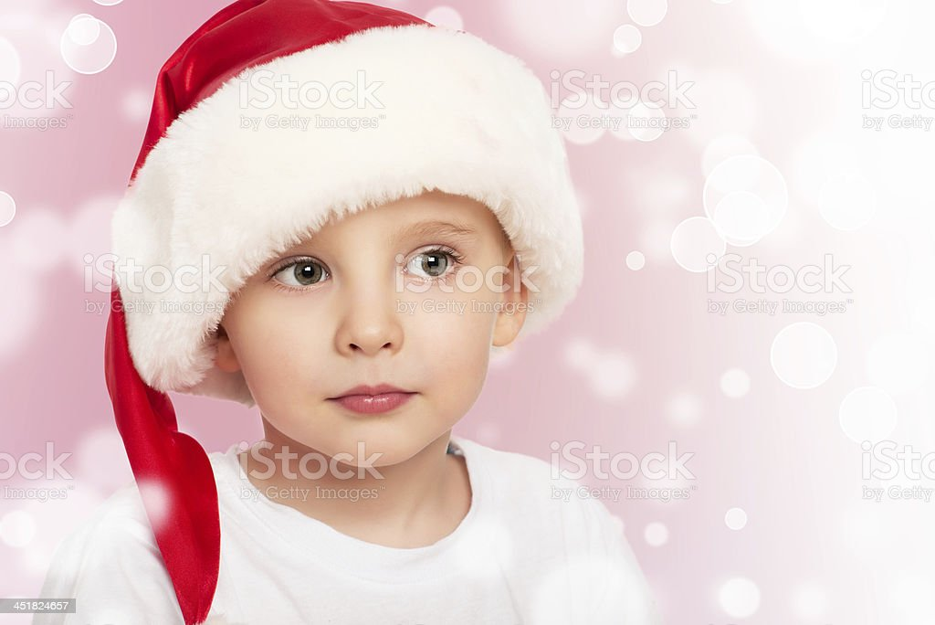 little  child boy in a Christmas hat royalty-free stock photo