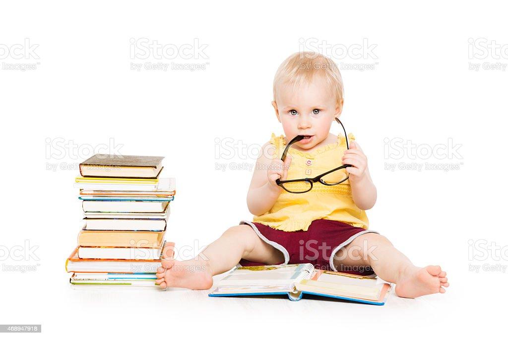 Little Child Girl Reading Book in Glasses, Children Early Development stock photo