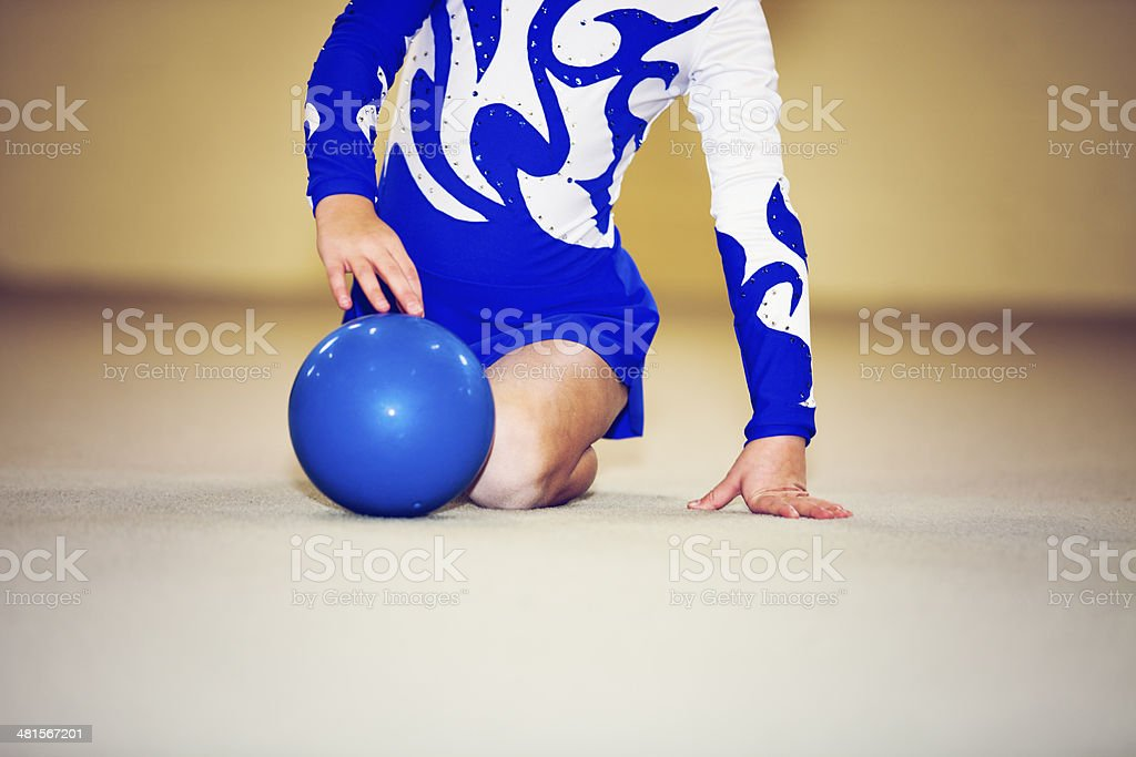 Little child gymnast with ball stock photo