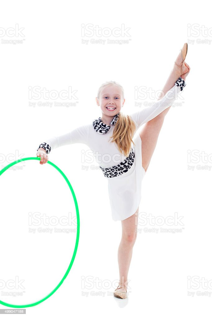 Little child gymnast with hoola hoop stock photo