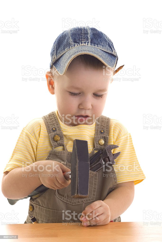 Little child hammers in nail by hammer royalty-free stock photo