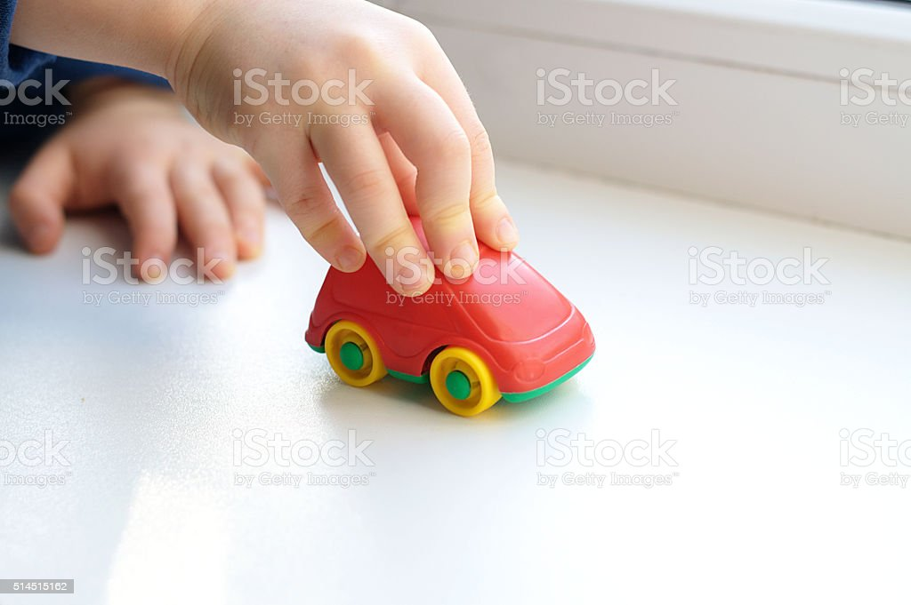 Little child hand close up playing toy stock photo