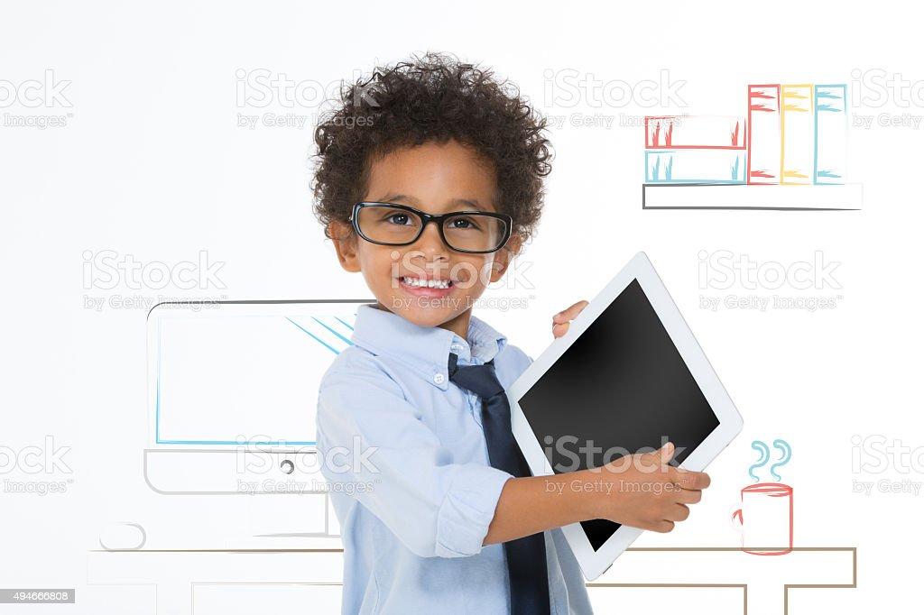 little child holding tablet stock photo