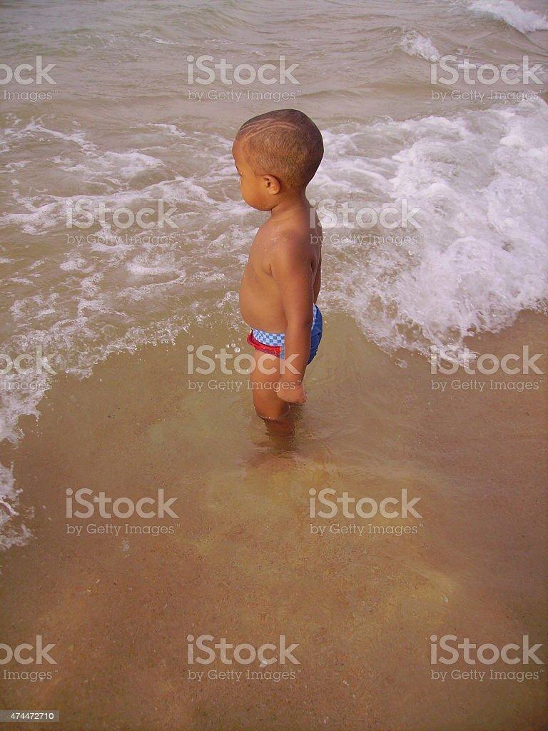 Little Child in Beach Dakar stock photo