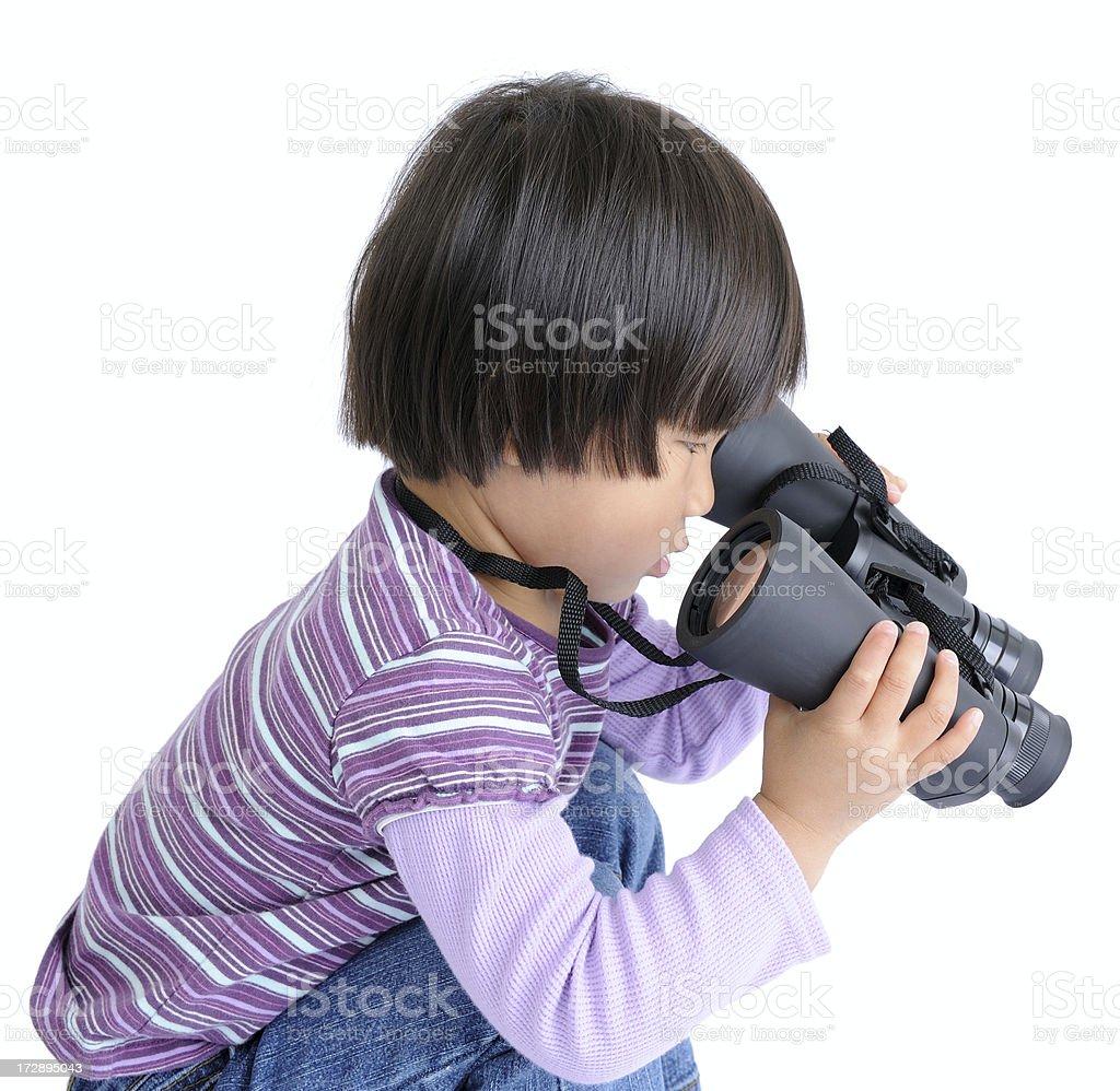 Little Child Looking Through Binoculars Backwards stock photo