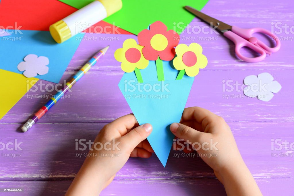 Little child made paper crafts for mother's day or birthday stock photo