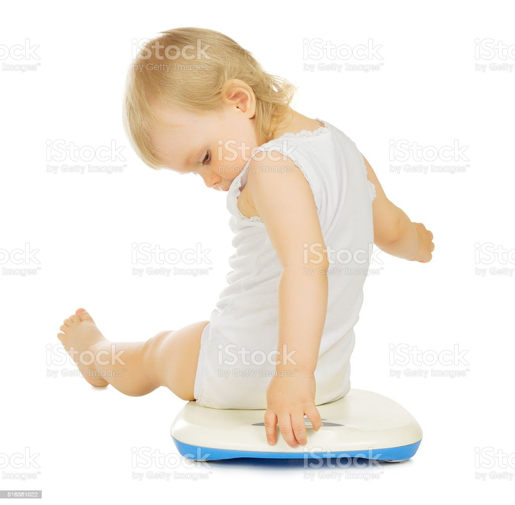 Little child on scales stock photo