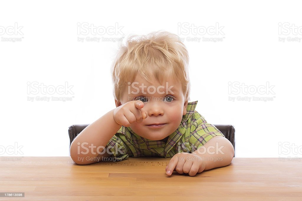 Little child pointing finger to someone royalty-free stock photo