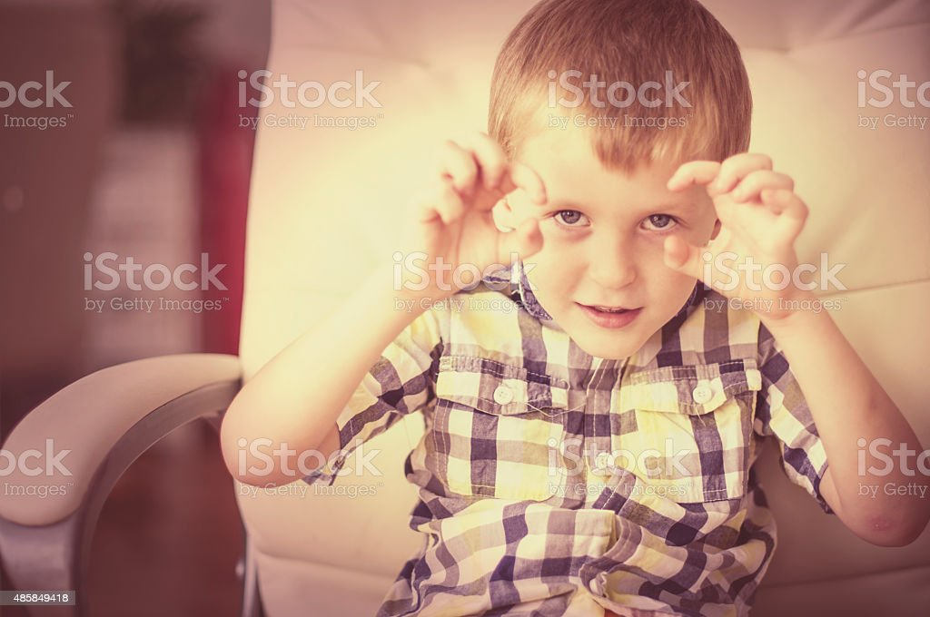 Little child tells a scary story stock photo