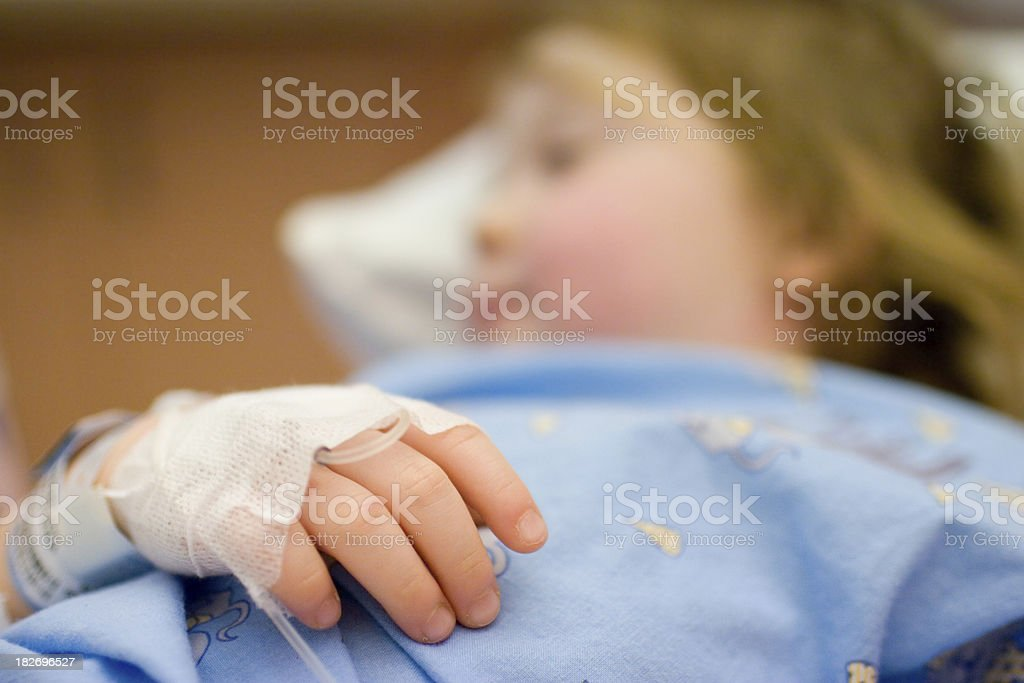 Little child, tied to the hospital bed stock photo