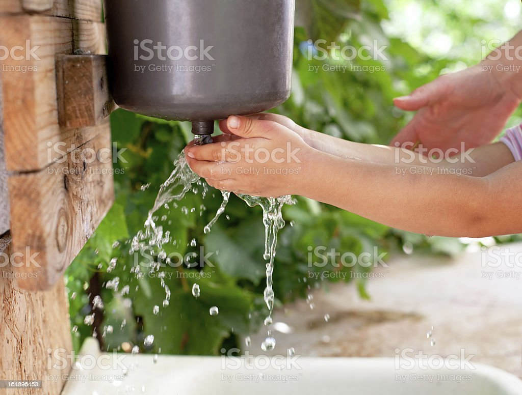 Little child washing hands royalty-free stock photo