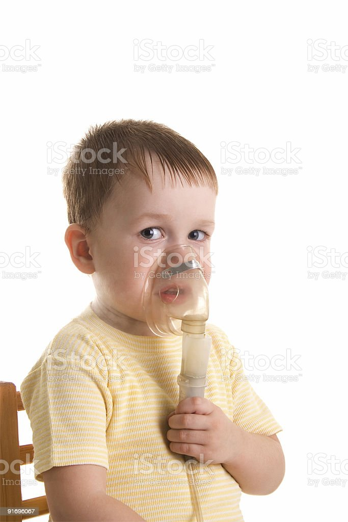 Little child with inhalation mask stock photo