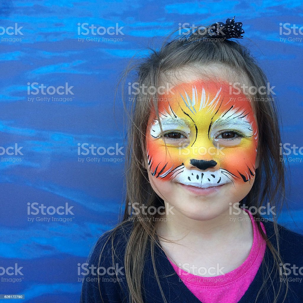 Little child with lion face painting stock photo