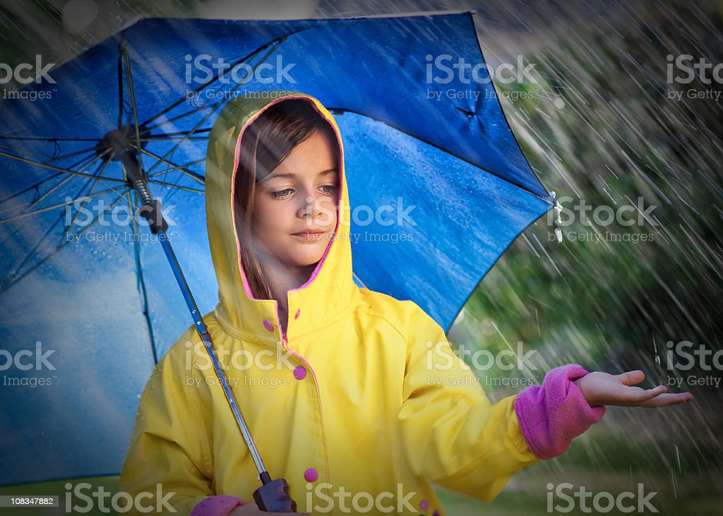 Little Child with Umbrella in the Rain royalty-free stock photo