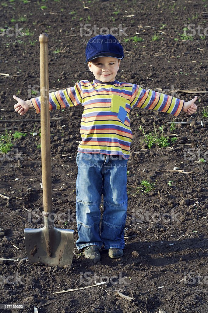 Little children with big shovel royalty-free stock photo