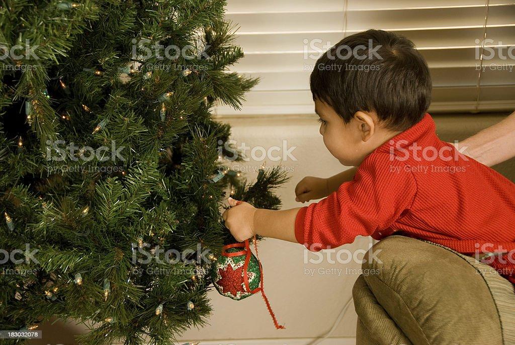 Little Christmas Tree Decorator royalty-free stock photo